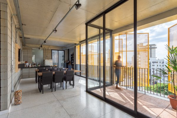 The lower level commercial space features workbenches for up to 14 students, a wine cellar, and a kitchen. Marco Franchini's father runs evening classes here three times weekly.