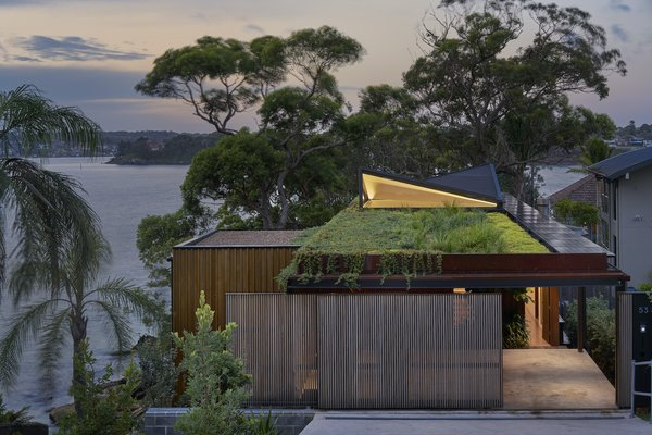 "Bundeena Beach House connects the street and wider community to the water views beyond thanks to its low-lying form and a native roof garden, which the architect describes as a ""green infinity edge."""