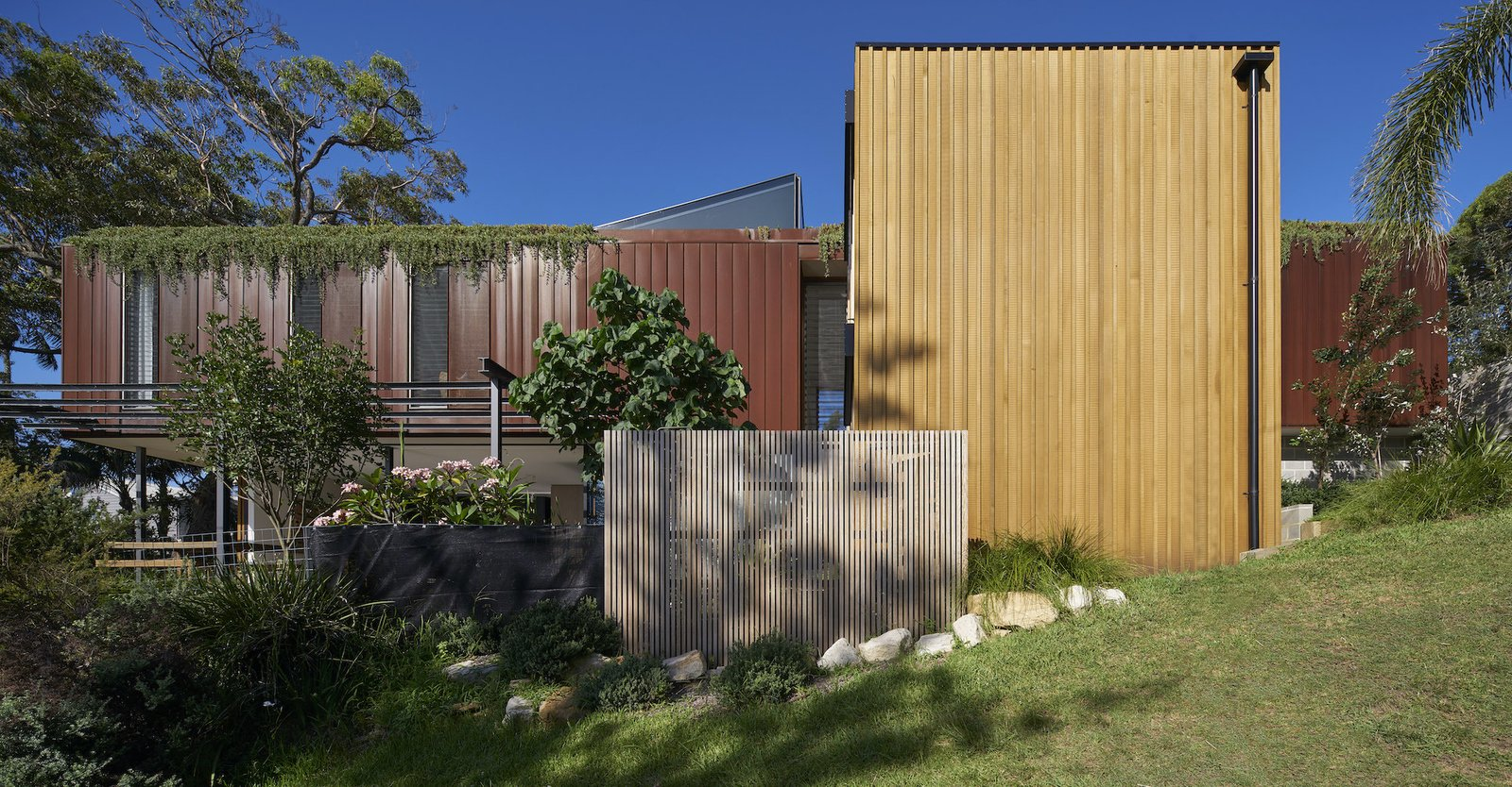 Bundeena Beach House by Grove Architects steel and wood exterior