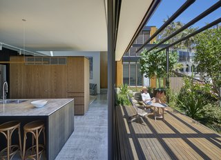 The timber deck extends the living space outside to create an indoor/outdoor living environment.