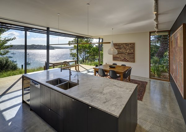 The kitchen and dining space opens out onto the timber terrace, which has expansive water views.