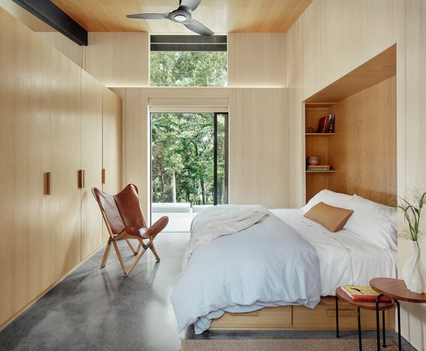 Like all the interior rooms, the furniture elements in the master bedroom have been built into the architecture, making efficient use of the compact space.
