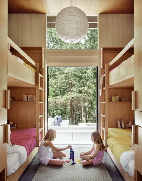 The home has a master bedroom and a bunk room with four beds. The clients' two daughters enjoy completely disconnecting from technology when spending time in the weekend retreat.