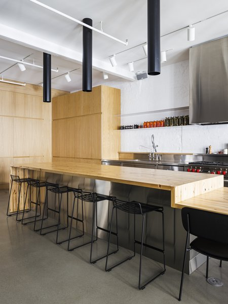 The kitchen is inspired by the commercial kitchens that the client worked at in his youth.
