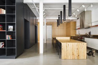 The apartment renovation takes raw, industrial materials and celebrates them in a refined way.