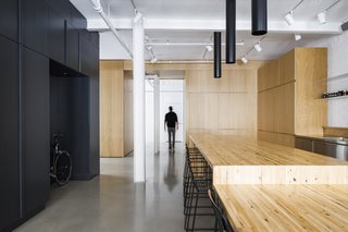 The client leads an active lifestyle, and the design team had initially planned on putting a climbing wall in one corner of the apartment. While this feature didn't make it into the final design, there is abundant storage for bikes and ski gear.