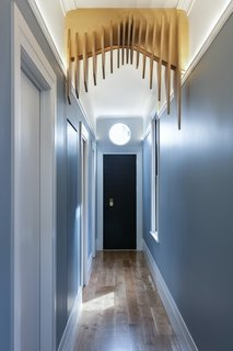 """The Edwardian hallway arch had been removed from the original home, and the design team was determined to reinstate it in the renovation. When the project became a new build, they decided to continue with the reinstatement of the arch in a more contemporary way. """"We have played with CNC in the past, and the outcomes have been successful,"""" says Spencer. """"So, we decided to create an arch that undulates in the x, y and z planes."""""""