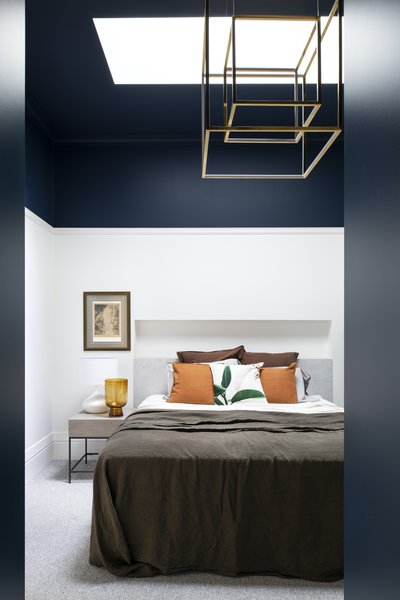"""The master bedroom's midnight blue ceiling is extremely seductive and calming,"" says Spencer. ""I genuinely encourage people to explore options that are a little out of the box."""