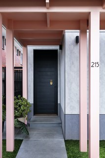 """The smooth cladding on the front facade is Cemintel Barestone. """"This is one of our favorite materials,"""" says Spencer. """"It's a weather-rated fiber cement sheet that doesn't require painting."""" This is contrasted with the darker, textured Equitone through-colored facade panels that ground the home."""