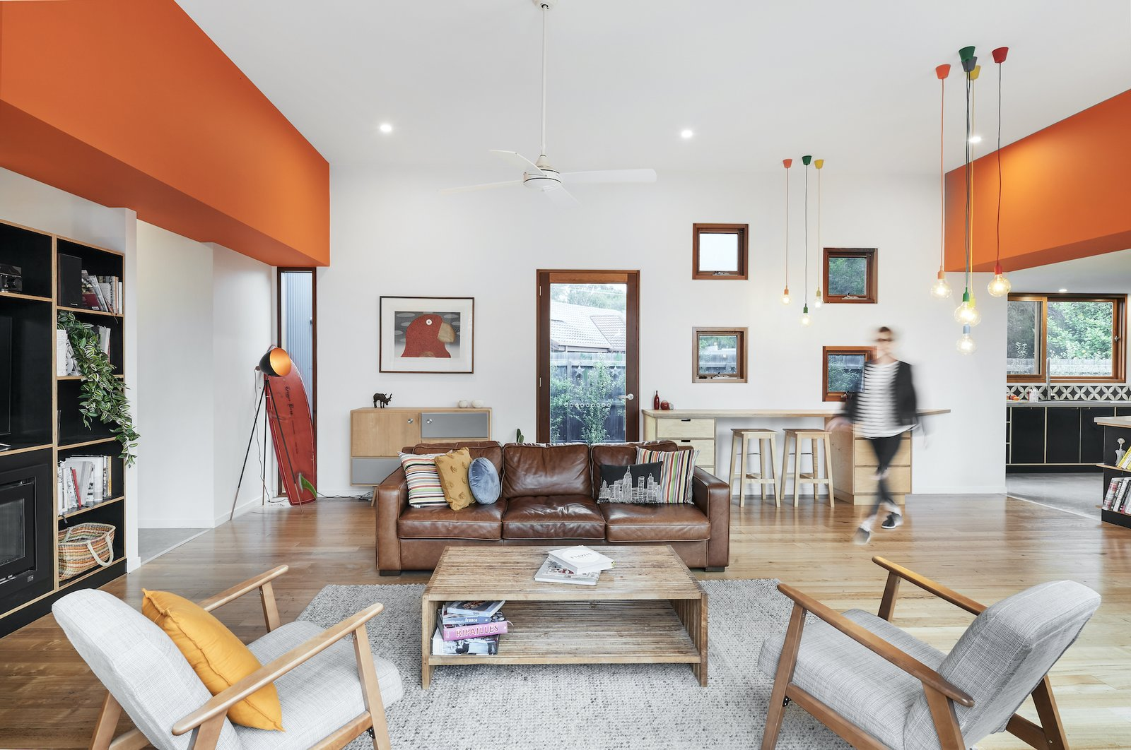 Living room at The FUN House by Nine Muses Architecture & Design.