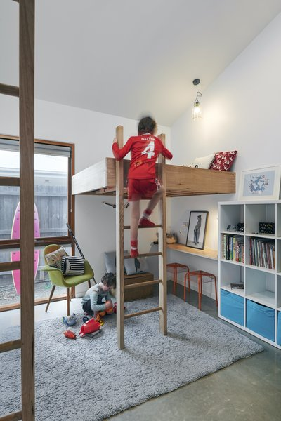 The boys' bedrooms have loft beds that create play spaces below. As a result, their toys are stored and used in their bedrooms instead of shared living spaces.