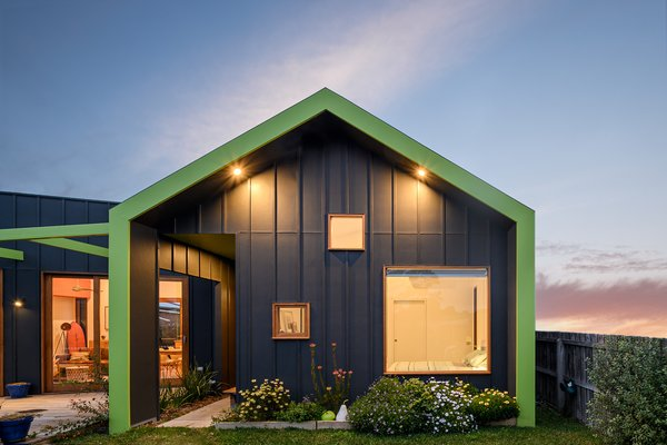 A green wraparound fascia and staggered windows provide a quirky welcome and set the tone for The FUN House.