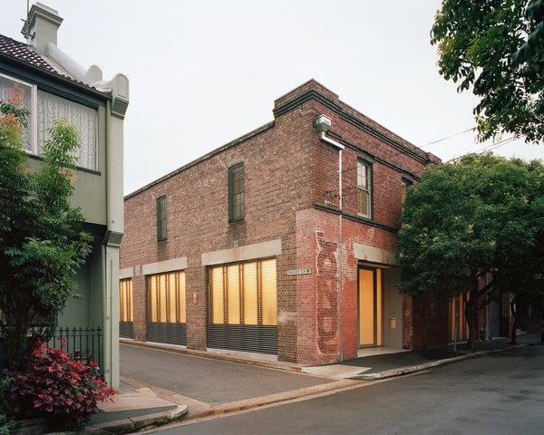 The building has served as everything from a Vegemite warehouse to an advertising agency over the years. The street-side windows have external operable aluminum louvers for privacy and sun-shading.