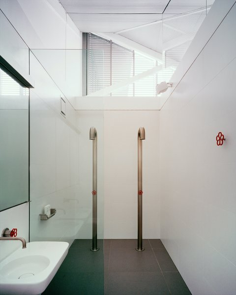 """The taps and showers are from the Pipe collection by Marcel Wanders for Boffi. """"I have always liked this product but never had an opportunity to use it,"""" says architect Ian Moore. """"When my clients said they wanted to retain a feeling of the original industrial character of the building, I thought it would be the perfect opportunity to use them."""""""