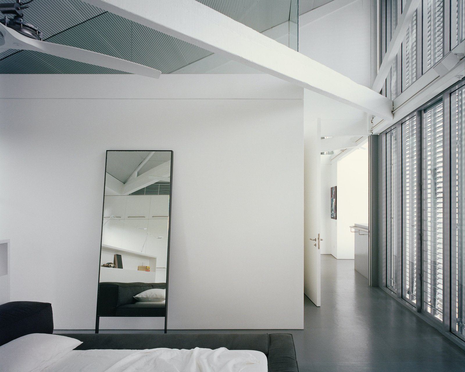 Bedroom of Redfern Warehouse by Ian Moore Architects.