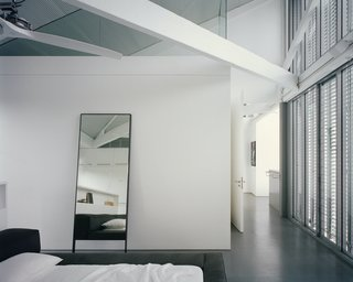 The master bedroom has a view back across the courtyard to the living space and the terrace beyond.
