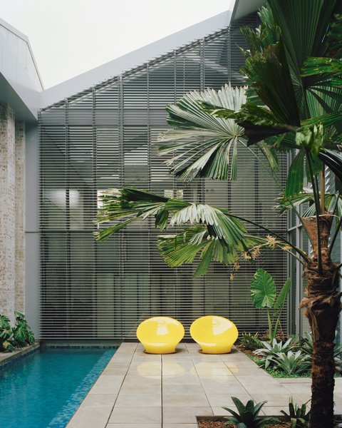 The outdoor spaces—including a courtyard with a small pool—were formed by simply removing the original roof toward the end of the construction, allowing dry working conditions for the majority of the construction period.