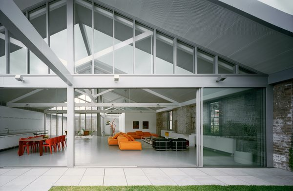 A terrace (with a lawn for the children and dog to play on) runs the full width of the living space and is accessible through large glazed doors.
