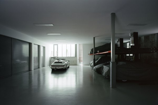 The garage—a clean and well-lit space with an epoxy floor—takes inspiration from Formula One pits. It can accommodate 10 cars—eight on four two-car stackers, plus spaces for the family car and a racing car.