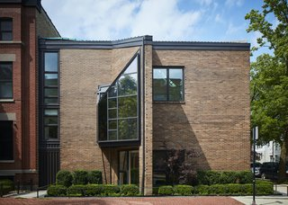 The mostly blank brick-clad exterior belies the complex geometries that inform the multilevel plan inside. The windows are arranged to frame specific views—including the steeple of the nearby St. Michael's Church—while retaining privacy from the street.