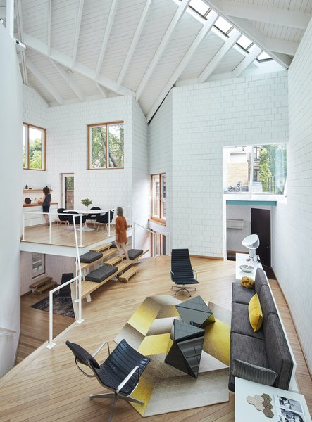The materials used in the house—concrete blocks and oak floors—are modest, and the detailing is very simple and often workmanlike. The white concrete block walls were repainted in Benjamin Moore's Chantilly Lace during the renovation.