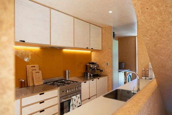 The kitchen has a simple design and utilizes low-cost materials so that the client could fabricate it using a limited selection of tools.