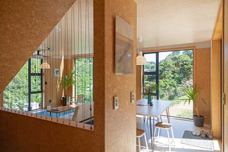 Large windows frame views of the surrounding bush, inviting the landscape inside.