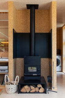 The solid ceramic fireplace in the downstairs living room can hold heat overnight.