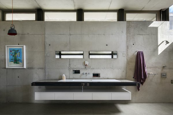 The bathroom counter tops are crafted from concrete, which was cast on-site and polished.