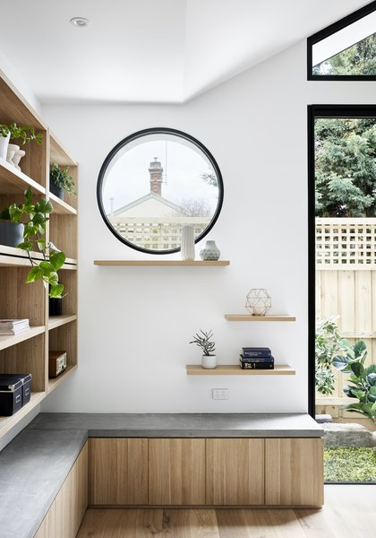 A timber display positioned below the porthole window in the living space offers a lookout for the owner's cat.