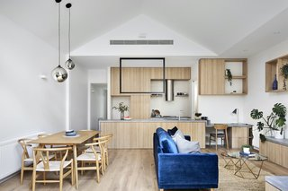 "A ""cathedral"" roof above the open-plan living area creates a sense of volume in the small space. The storage is all contained in carefully planned bespoke joinery units."
