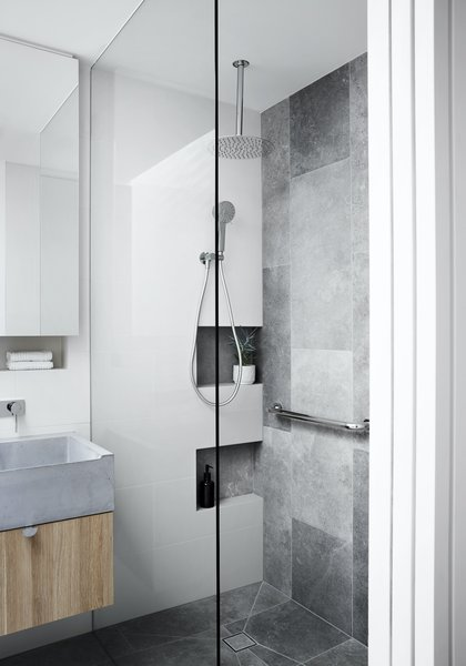 The home was designed with future accessibility in mind. The spacious shower has a grab rail, and the home is laid out over a single story for easy access.