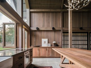 The entire interior—including bespoke joinery and furniture—is crafted from timber.