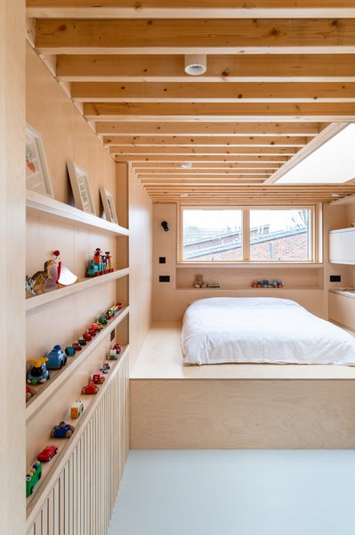 Although the loft bedroom is contained in a half-height extension, it still feels spacious and light. The bed sits atop a platform that accommodates the head height of the room below.