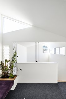 """The retreat is open to the stair void, giving it a mezzanine-like quality. """"In terms of spatial layout, the sequencing was really important, because it allows for easy movement between the rooms, which are all somehow connected yet still quite self-contained,"""" says architect Dan Gayfer."""
