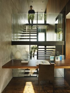 All three floors are connected by a singular sculptural stair that unifies the experiences within the home.