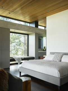 The top floor, where the master bedroom is located, incorporates south- and north-facing clerestory windows to bring additional natural light to the interior.