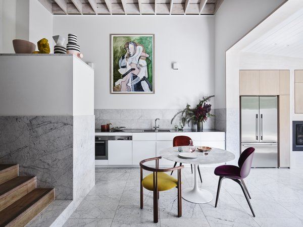 "The home's philosophy was inspired by the works of Alvar Aalto and Louis Kahn. The use of locally available and low-cost pine and Carrara stone gives it an almost Scandinavian sensibility, which the couple describe as ""Scandi meets carpentry modernism."""