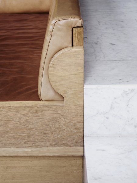 The bespoke joinery of the custom oak and leather banquette was inspired by simple Scandinavian forms.