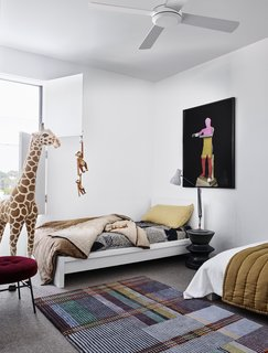The twins' loft bedroom features a Scott Rug by Wallace + Sewell, and an ILOT stool by Amaury Poudray for Ligne Roset.