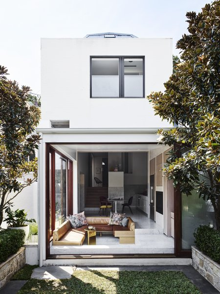 The home presents as a simple terrace cottage to the street, however it opens up to a surprising and textural collection of volumes inside. It steps down the gently sloping site toward the western garden, where stairs create small amphitheaters for sitting.