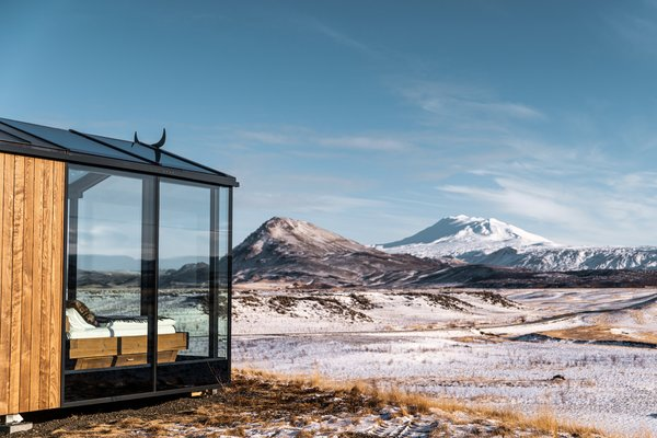 """The cabins overlook the Hekla volcano, one of Iceland's most active volcanoes. It is part of a 25-mile-long volcanic ridge, and during the Middle Ages it was referred to by Europeans as the """"Gateway to Hell."""""""