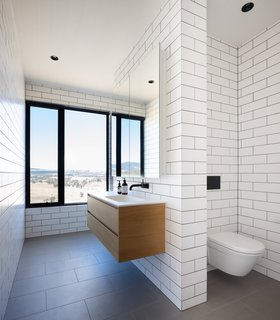 Even the bathrooms have spectacular views. A skylight allows glimpses of the sky from the shower.