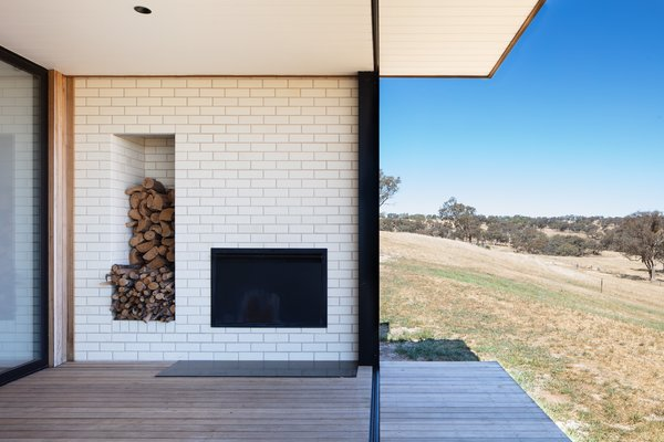 The outdoor fireplace is one of the defining features of the home.