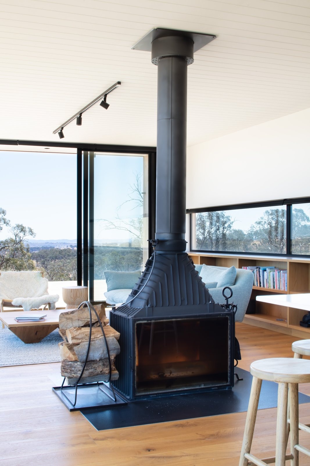 Living room with fireplace at Kangaroobie by Modscape.