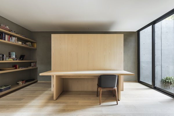 A bespoke oak desk in the more private family room on the first floor offers a space for family members to work or study in private.