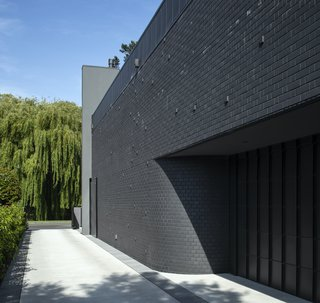 """The curve leading into the garage was dictated by planning regulations, which necessitated a turning circle in the driveway. """"I don't think you should treat planning regulations as hindrances,"""" says architect Phil Redmond. """"Instead, you should take them as an opportunity to design something interesting."""""""