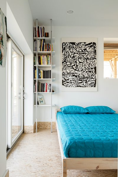 """In the basement of a Sag Harbor A-frame, Edgar Papazian installed light-colored walls and structural-grade OSB floors. """"It's derisively called 'snot board' in the industry,"""" he notes. """"But, it is a durable, visually pleasing solution that has aged very well."""""""