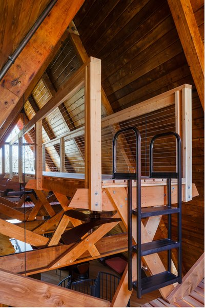 The timber mezzanine structure was designed to match the existing structure of the home. Exposed Douglas fir dimensional lumber was used throughout. It was stained with a particular water-based Shaker stain mix to imbue the wood with a warm hue and define it from the original house elements.