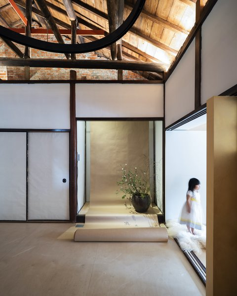 "JC Architecture restored the original walls and installed a new timber floor that was inspired by Japanese tatami mats. ""We were very inspired by the old Japanese way of looking at space,"" says Chu. ""Shoji doors, for example, allow two spaces to be easily transformed into one large space. All the doors in the home operate the same way as the Japanese system, creating flexibility in the interior."""
